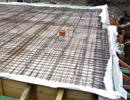RC foundation slab with thermal insulation and PVC foil under the base plate